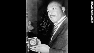 Caption:\t US clergyman and leader of the Movement against Racial Segregation Martin Luther King, displays 10 December 1964 in Oslo his Nobel Peace Prize medal. The only black man whose birthday is a national holiday, Martin Luther King was the leader of the moral fight against racism in America wen he was fatally shot by James Earl Ray 04 April 1968 at the age of 39. (Photo credit should read -/AFP/Getty Images)