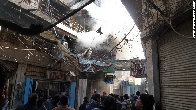 Smoke billows after an explosion in the business district of Al-Sanak in central Baghdad on February 5, 2014.