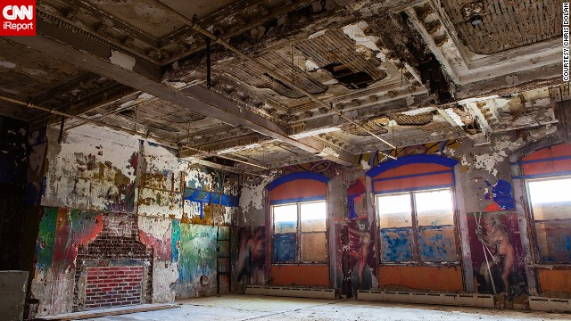 """Dolan photographed Hotel Sterling in Wilkes-Barre, Pennsylvania, three weeks before the 2013 demolition. Not much was left. This small corner of the hotel's once grand lobby holds a fireplace that might have warmed guests in its hey day but was now covered with graffiti. """"I was very disappointed when I walked in and found that it was nothing more than a wide open shell,"""" Chris Dolan said."""
