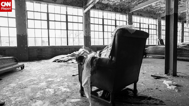 Taken outside the factory's famous bowling alley, this photo features a rather out-of-place leather chair facing the many large windows.