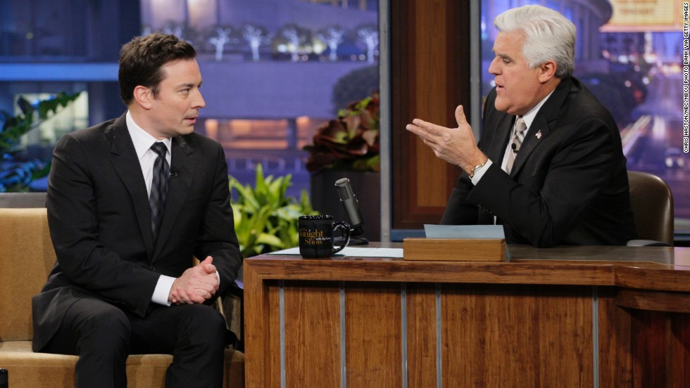 """Jay Leno, right, interviews Jimmy Fallon during a taping of """"The Tonight Show"""" on Monday, February 3. Leno will be handing over the late-night talk show to Fallon this month, ending his 22-year reign as a king of late night. Here's a look back at Leno's career."""