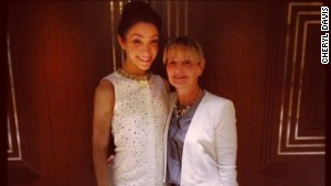 Olympic ice dancer Meryl Davis smiles beside her mom, Cheryl.
