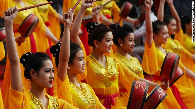 FEBRUARY 5 - HANOI, VIETNAM: Dancers perform next to a statue of King Quang Trung in Hanoi on February 4 during a ceremony marking the 225th anniversary of the Vietnamese Ngoc Hoi-Dong Da victory over the Chinese Qing army.
