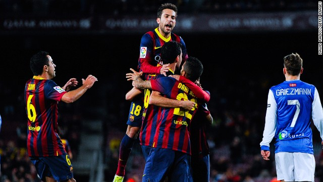 Sergio Busquets is mobbed after breaking the deadlock against Real Sociedad in Camp Nou on Wednesday.