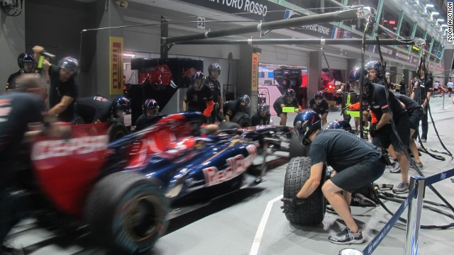 """I took the photo in Singapore 2013,"" explains Toro Rosso boss Franz Tost. ""This pit stop highlights key elements of the sport, namely speed, precision and teamwork."""