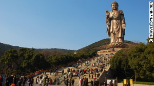 China builds bigger Buddhas to entice tourists