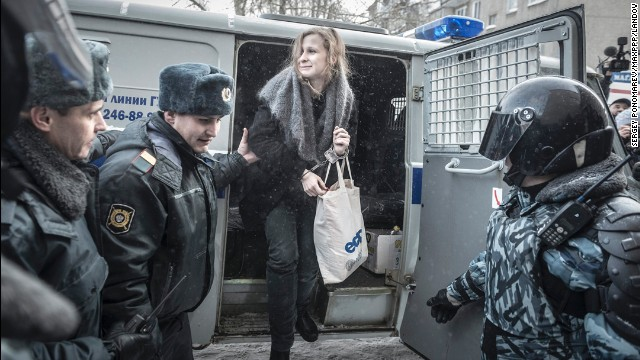 Alyokhina is escorted to a court hearing in Berezniki, Russia, in January 2013.
