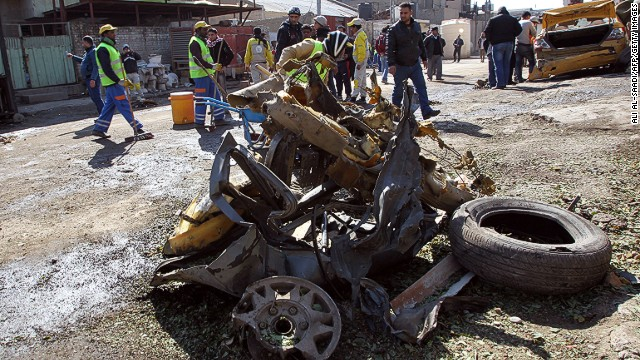 The site of a car bomb explosion in the industrial Camp Sarah district of central Baghdad on February 6, 2014.