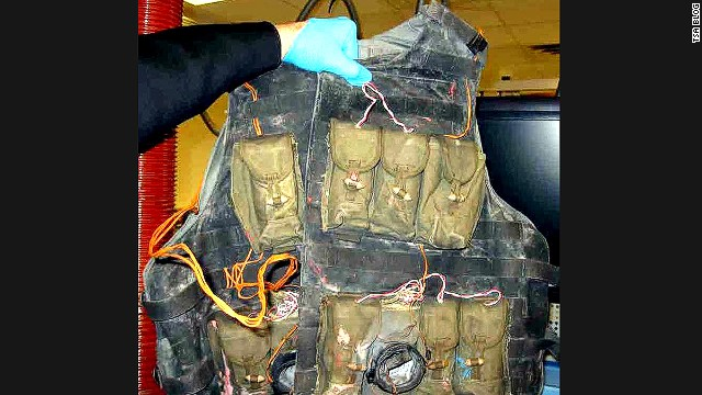 An inert suicide vest was also found. Inert and replica weapons are just as likely to be confiscated as real ones, the TSA says.