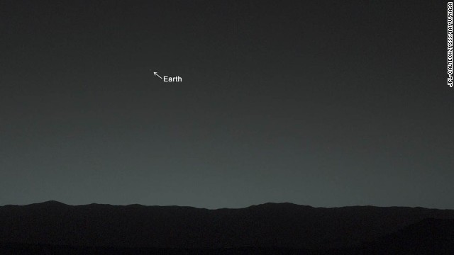 "This view of the twilight sky and Martian horizon, taken by NASA's Mars rover Curiosity, includes Earth as the brightest point of light in the night sky. Earth is a little left of center in the image, and our moon is just below Earth. A human observer with normal vision, if standing on Mars, could easily see Earth and the moon as two distinct, bright ""evening stars."""