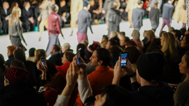 Instagram, and Twitter, and Facebook, oh my! The audience photographs the Richard Chai fashion show on February 6, 2014.