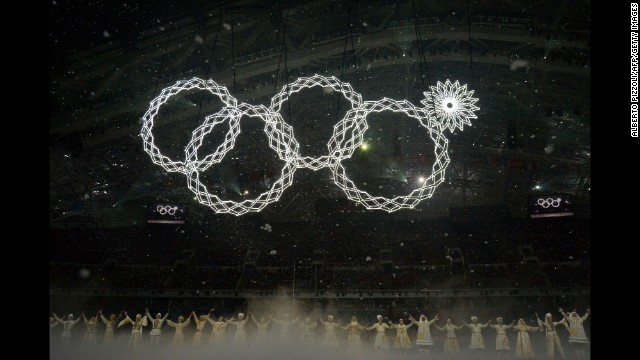 The Olympic rings are presented during the opening ceremony -- but there seemed to be a malfunction on the top right ring.