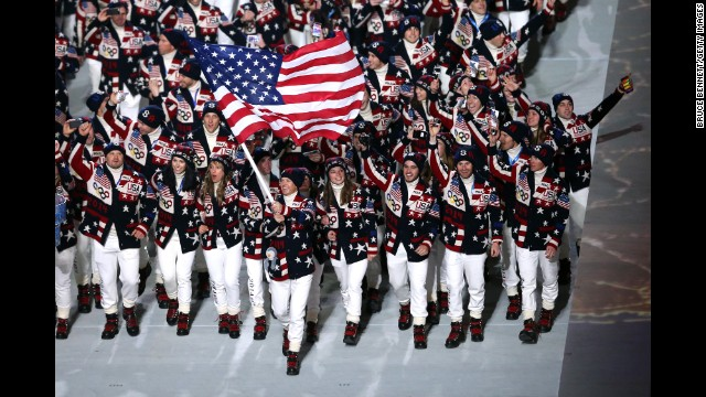 Skier Todd Lodwick carries the American flag during the opening ceremony.