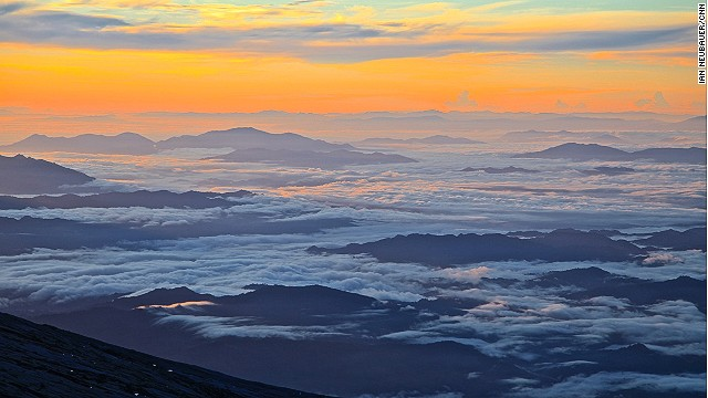 The sun rising over Sabah as seen from the summit at Low's Peak, named after former British Colonial Administrator Hugh Low, who made the first documented ascent of Mount Kinabalu's summit plateau in 1851.
