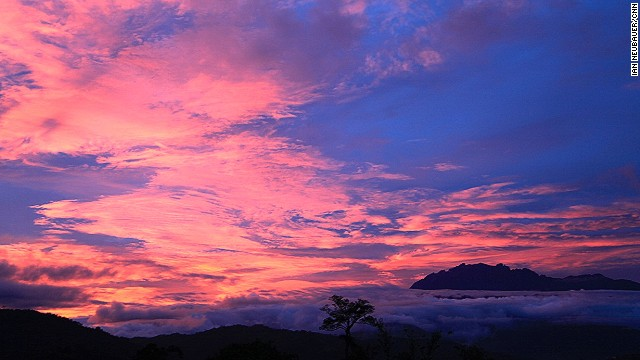 The sunrise changes throughout the morning. Here, it's illuminated in steaks over the Crocker Range, a mountainous spine with an average height of 1,800 meters that divides the west and east coasts of Sabah.