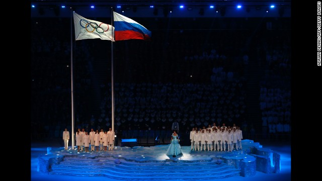 Russian soprano Anna Netrebko sings the Olympic Anthem.