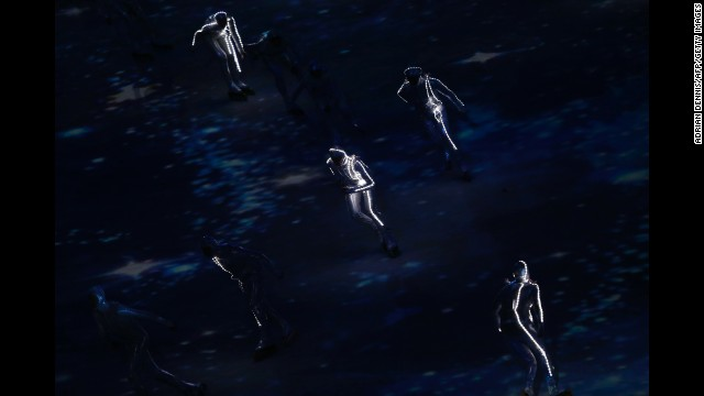 Performers skate around the stadium floor during the ceremony.