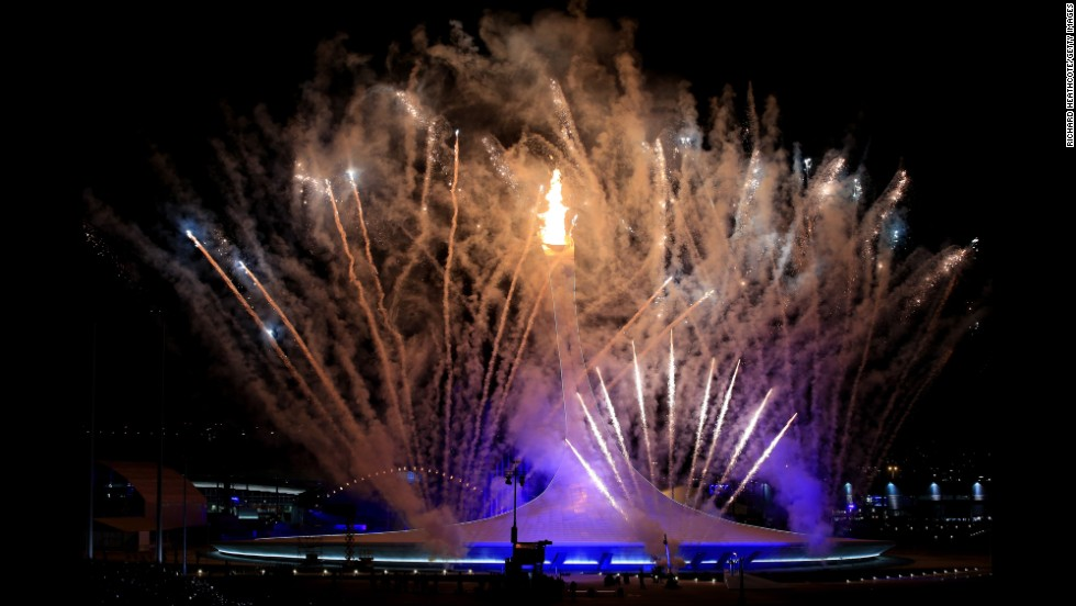 Fireworks explode over Fisht Olympic Stadium in Sochi, Russia, as the Olympic cauldron is lit during the opening ceremony of the 2014 Winter Games on Friday, February 7.