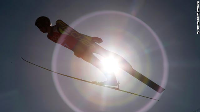 FEBRUARY 7 - KRASNAYA POLYANA, RUSSIA: Czech Republic's Roman Koudelka trains for the men's ski jump at the 2014 Winter Olympics. <a href='http://cnn.com/2014/02/07/world/europe/russia-sochi-winter-olympics/index.html?hpt=hp_t2'>Russia kicks off the opening ceremony Friday </a>in Sochi as the world turns its attention to the costliest Olympic Games in history.