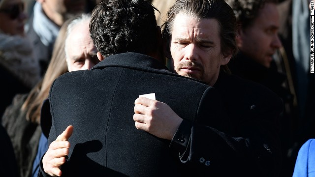 Actor Ethan Hawke hugs another mourner after the service.