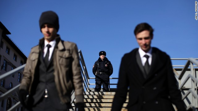 A Russian police officer stands guard on an overpass in Krasnaya Polyana on February 7.
