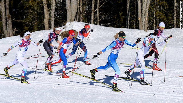 Cross-country skiers compete in the women's skiathlon.