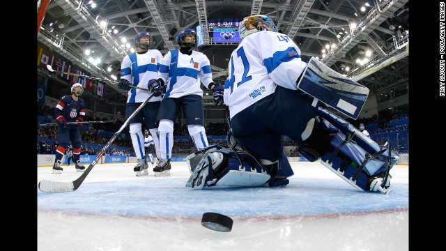 Finnish goalie Noora Raty allows a goal during a women's ice hockey game against the United States.