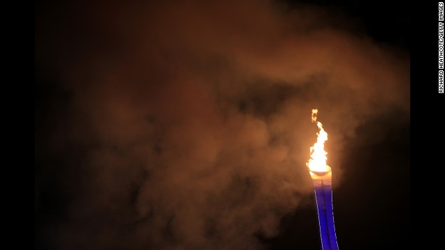 The Olympic cauldron is lit during the opening ceremony.