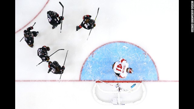 Canada's women's hockey team celebrates after scoring a goal against Switzerland during their preliminary round game February 8.