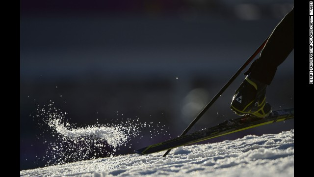 Snow flies on February 8 during the men's 10-kilometer biathlon sprint.