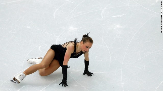 Germany's Nathalie Weinzierl takes a fall during the team figure skating event.