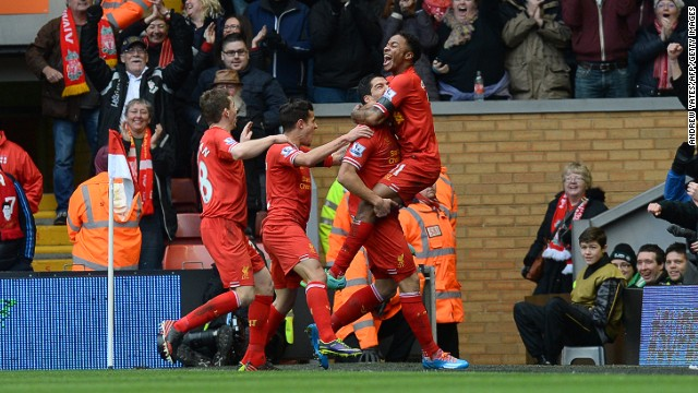 Raheem Sterling (right) celebrates with his teammates after scoring Liverpool's third goal against Arsenal at Anfield on Saturday.