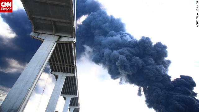 Thick smoke rises from the warehouse fire.