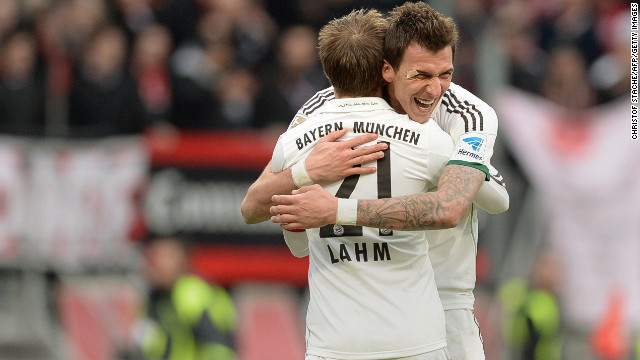 Croatian striker Mario Mandzukic (right) embraces Philipp Lahm after the German defender scored in the 2-0 win a Nuremburg.