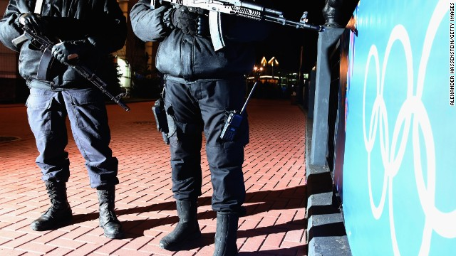 Police offices perform a security patrol around the Rosa Khutor Mountain Cluster village during the opening ceremony on February 7.