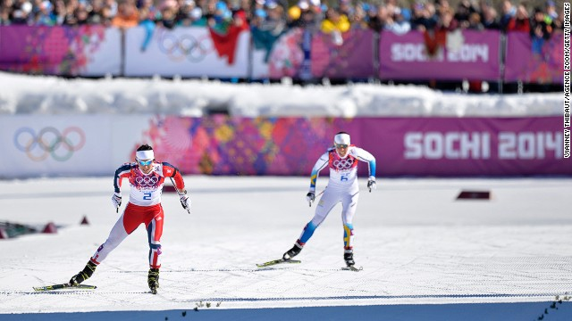Norway's Marit Bjoergen (left) skis her way to gold in the women's skiathlon ahead of Charlotte Kalla of Sweden.