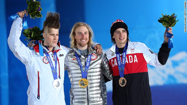 (From left to right) Silver medalist Staale Sandbech of Norway, gold medalist Sage Kotsenburg and bronze medalist Mark McMorris of Canada wave to the crowds from the podium following snowboard slopestyle medal ceremony.