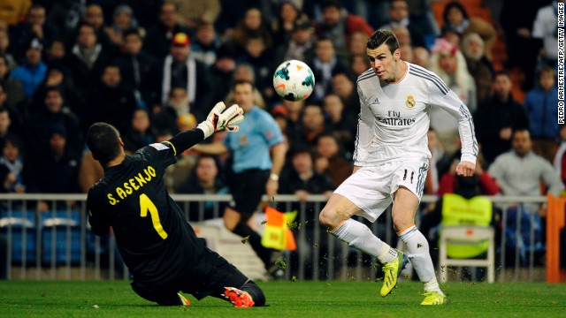 Gareth Bale dinks the ball over Villarreal keeper Sergio Asenjo to put Real Madrid ahead in the Bernabeu on Saturday.