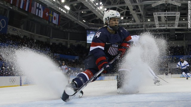 Brianna Decker of the United States fights for the puck during a Group A match between the U.S. and Finland on February 8.
