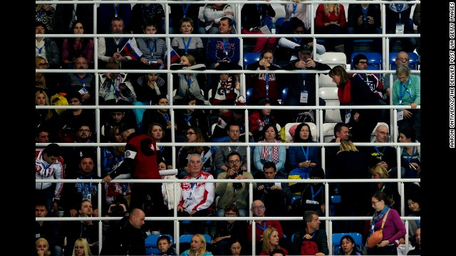 Fans watch the women's short program during team figure skating on February 8.