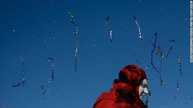 Streamers and confetti fly through the air as performers entertain fans February 8 at the Olympic village.