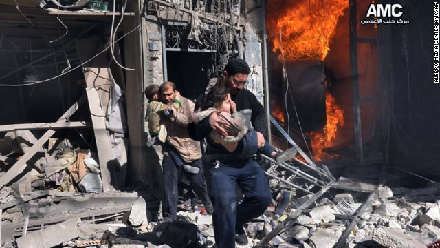 In this photo provided by the anti-government activist group Aleppo Media Center, Syrian men help survivors out of a building in Aleppo after it was bombed, allegedly by a Syrian regime warplane on Saturday, February 8. The United Nations estimates more than 100,000 people have been killed since the Syrian conflict began in March 2011. Click through to see the most compelling images taken during the conflict, which is now a civil war: