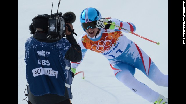 Austria's Matthias Mayer reacts in the finish area during the men's downhill. He won the gold medal.