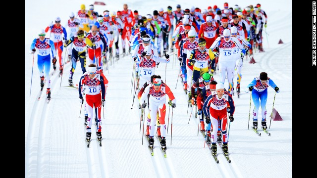 From left, Sjur Roethe of Norway, Alex Harvey of Canada and Martin Johnsrud Sundby of Norway lead the pack in the men's skiathlon event on February 9.