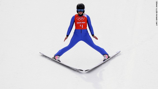 Chiara Hoelzl of Austria lands her jump during training for the normal hill ski jumping event.