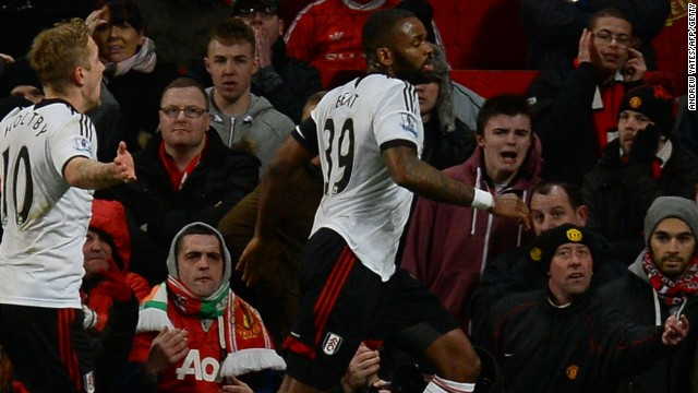 Darren Bent wheels away in triumph after scoring Fulham's injury-time equalizer against Manchester United at Old Trafford.