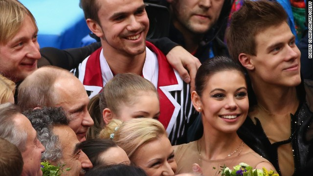 Russia's gold medalists in the team figure skating were congratulated after their triumph by President Vladimir Putin.