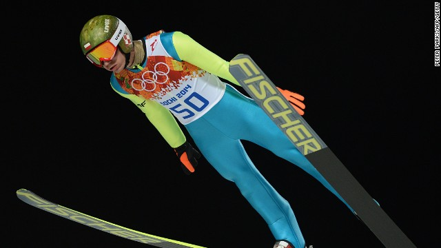 Kamil Stoch of Poland soars to victory in the ski-jumping normal hill competition one of eight golds claimed on the second day of finals in Sochi.