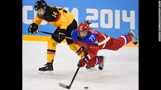 Germany's Jacqueline Janzen, left, vies with Russia's Inna Dyubanok during a women's ice hockey match on February 9.
