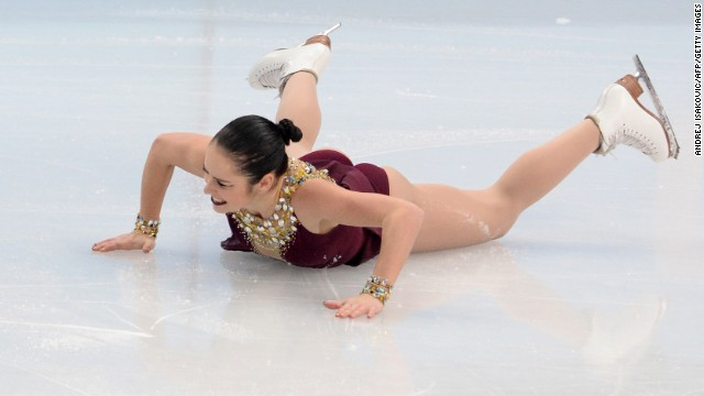 Canada's Kaetlyn Osmond falls as she performs in the women's free skate portion of the team figure skating event.